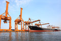 Big container ship on port with big pier lifting crane  use for Royalty Free Stock Photo