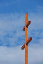 Big cross and a little bird resting on double opposites attract natural supernatural photo taken on may in Royalty Free Stock Photography