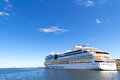 Big cruise ship long travel blue sky and water Royalty Free Stock Photography
