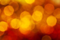 Big dark red yellow brown shimmering xmas lights abstract blurred background bokeh of garlands on christmas tree Stock Photos