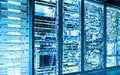 Big data dark server room with bright equipment Royalty Free Stock Photo