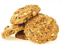 Big delicious pile of whole grains cookies on white background Royalty Free Stock Photography