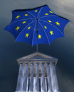 Big europe-flag umbrella standing over stocks exch Stock Photo