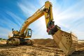 Big excavator in front of the blue sky Royalty Free Stock Photo