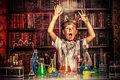 Big explosion a boy doing experiments in the laboratory in the laboratory science and education Royalty Free Stock Photo