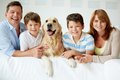 Big family portrait of happy with their pet looking at camera Stock Image