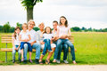 Big Family Sitting On A Bench Royalty Free Stock Photo