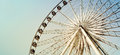 Big ferris wheel against blue sky processed with vintage style Royalty Free Stock Photo