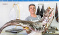 Big fish fisherman holding a corvina with about pounds kilos at the market Royalty Free Stock Images