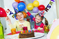 Big funny birthday party happy little children are having fun in a Stock Photos
