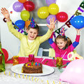 Big funny birthday party happy little children are having fun in a Royalty Free Stock Image