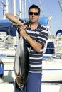 Big game fisherman with saltwater tuna Royalty Free Stock Photo