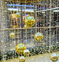 Big gold fir tree spheres and decorations Stock Photography