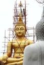 Big golden buddha statue under construction Stock Image