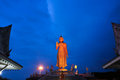 Big golden buddha statues largest at twilight in temple Stock Photo