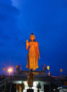Big golden buddha statues largest at twilight in temple Royalty Free Stock Image