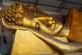 Big golden head of Reclining Buddha Image (Phra Norn) Royalty Free Stock Photo