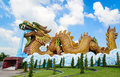 Big golden heaven Dragon at Pillar Shrine Suphanburi, Thailand, Royalty Free Stock Photo