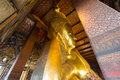 The big golden reclining buddha within wat pho is the important in bangkok thailand Stock Photo