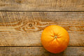 Big grapefruit on the wooden table close up isolated Royalty Free Stock Photo