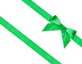 Big green bow knot on two diagonal silk ribbons Royalty Free Stock Photo