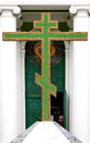 Big green christian golden cross at entrance to temple Royalty Free Stock Photo