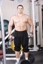 Big guy with dumbbells Stock Images