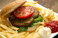 Big hamburger french fries and vegetables a Royalty Free Stock Images