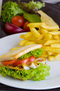 Big hamburger french fries and vegetables Royalty Free Stock Image