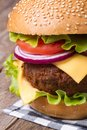 Big hamburger with meat cheese tomato onion and lettuce fresh closeup Stock Image
