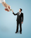 Big hand giving dollars to businessman Royalty Free Stock Photos