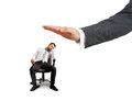 Big hand ready to slap lazy businessman on the chair photo over white background Royalty Free Stock Image