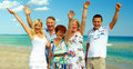 Big happy family waving hands on sea beach Stock Photo