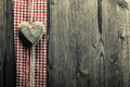 Big heart wood on plaid fabric Stock Images
