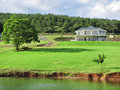 Big house with lawn next to lake shot in albert falls dam nature reserve kwazulu natal south africa Royalty Free Stock Photos