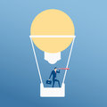 Big idea. Businessman flying in hot air balloon form lamp idea using telescope looking for success