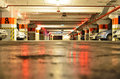 Big illuminated underground parking at the city mall with parked cars Royalty Free Stock Photos