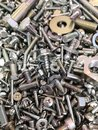 A big and interesting pile of new and shiny metal nuts and bolts, screws and washers. Royalty Free Stock Photo