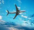 Big jet plane flying against perfect sky background Royalty Free Stock Photo
