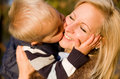 Big kiss for mom. Royalty Free Stock Photos