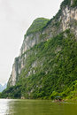 Big limestone cliff and bamboo boat on li river china Royalty Free Stock Photography