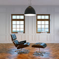 Big living room with lounge chair in center and big windows Royalty Free Stock Photo