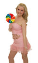 Big lollipop young blond girl holding multicolored and smiling isolated Royalty Free Stock Photos