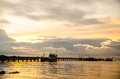 A big long fishing pier at sunrise thailand Stock Image