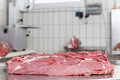 A big lump of raw meat lying on the steel table Stock Images