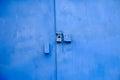 Big metal door blue dark paint and lock. Royalty Free Stock Photo