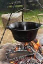 Big metal pot on camp fire Royalty Free Stock Photo