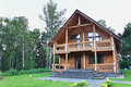 Big Modern Wooden House Made of Logs Royalty Free Stock Photo