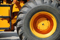 The big new yellow wheel Stock Image