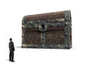 Big old treasure chest with small man looking at Royalty Free Stock Photo